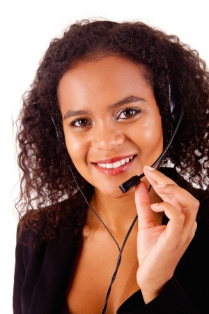 Beautiful african call center woman at work smiling with headset  photo