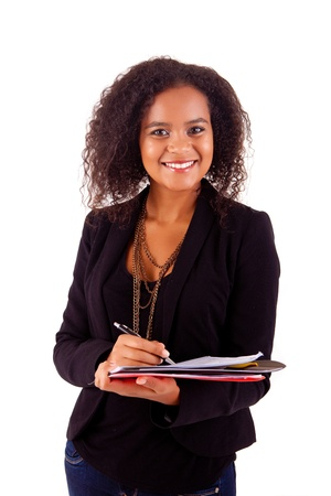 Beautiful african woman scheduling an appointment Stock Photo - 17347494