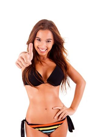 Beautiful bikini woman showing thumbs up on white background