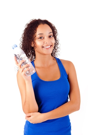 Beautiful african woman holding a water bottle photo