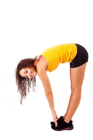 Pretty young african woman doing exercise - Fitness Concept photo