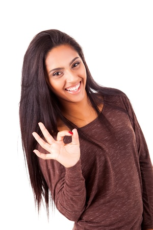 Beautiful mix race woman showing Ok sign over white background