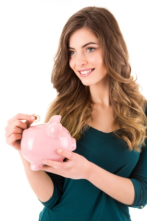 Casual woman looking to save money in a piggy bank Stock Photo - 17538860