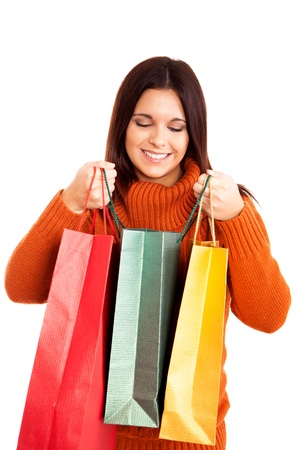 beautiful woman holding shopping bags over white background Stock Photo - 17574070