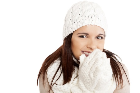 Beautiful woman wearing winter clothes over white background photo