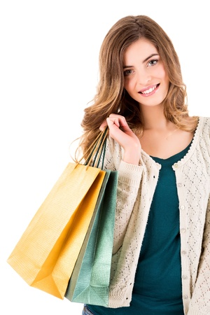 Beautiful woman holding shopping bags over white backgroung Stock Photo