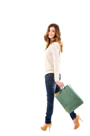fancy bag: Beautiful woman holding shopping bags over white backgroung Stock Photo