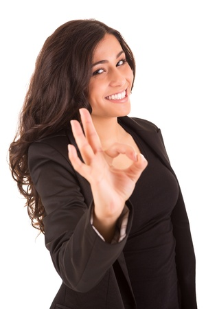 Business woman with an ok sign - isolated over a white background photo