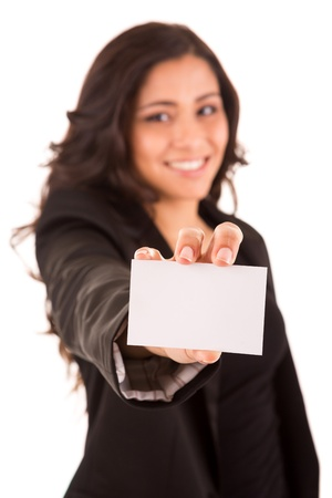 Friendly woman holding a business card and smiling - selective focus on hand photo