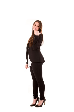 Young beautiful female business executive pointing at copyspace photo