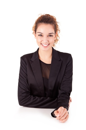 Pretty young business woman smiling on white background photo