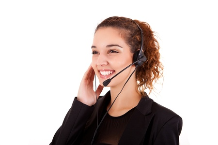 costumer: Portrait of a happy young call center employee smiling with a headset over white Stock Photo