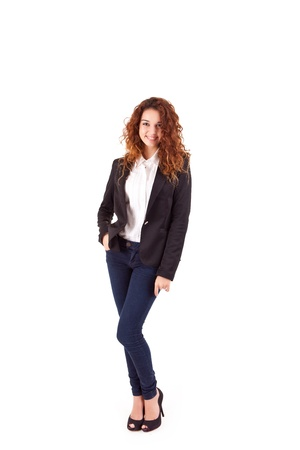 Young beautiful casual business woman posing over white background photo