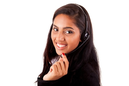 Portrait of a happy young mix race call center employee smiling with a headset over white photo