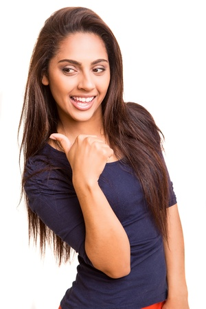 thirties portrait: Pretty mix race woman pointing with her arm over white background