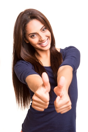 Beautiful mix race woman showing thumbs up over white background photo