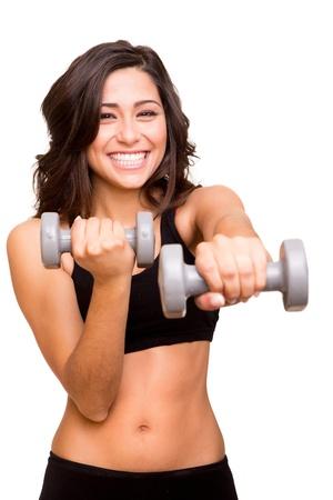 Beautiful fitness woman lifting weights Stock Photo