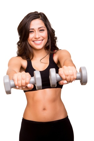 dumbells: Beautiful fitness woman lifting weights Stock Photo