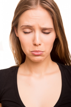 sceptic: Beautiful woman disappointed Stock Photo