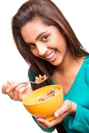 beautiful mix race woman eating cereals photo