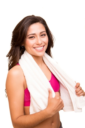 Attractive fitness woman posing with gym towel  Stock Photo