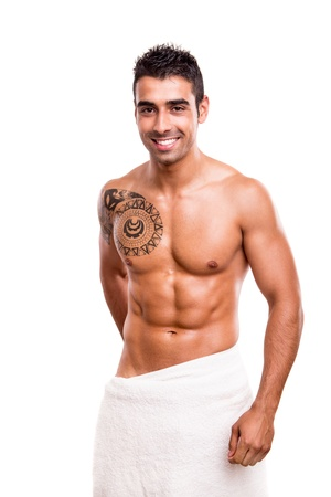 Attractive man posing with a white towel photo