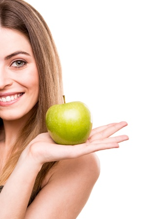 a tooth are beautiful: Portrait of a young woman eating green apple