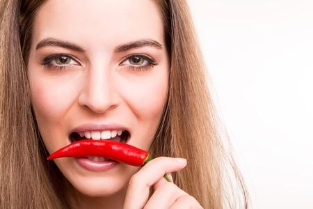 eye: Beautiful woman biting a red pepper