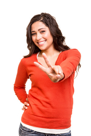 Beautiful young woman showing peace  victory sign photo