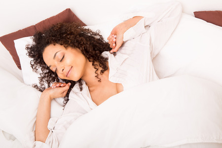 African woman slepping in bed photo