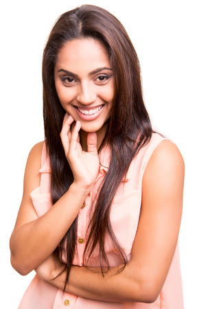 Beautiful ethnic woman posing over white background Stock Photo