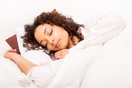 woman laying: African woman slepping in bed