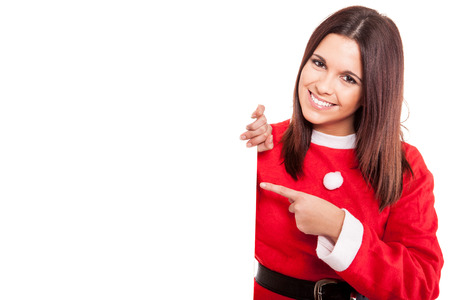 Beautiful Christmas woman pointing to a white banner photo