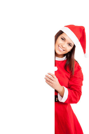 Beautiful Christmas woman holding a white banner photo