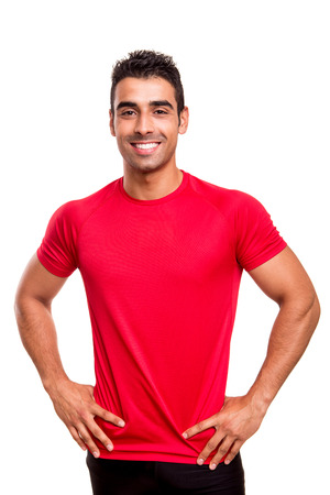 Smiling man posing over white background  photo