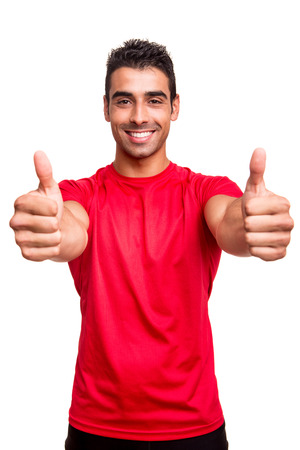 thumbs up symbol: Man showing thumbs up over white background