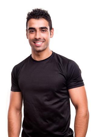 hombre flaco: Retrato de un instructor de gimnasio sobre fondo blanco Foto de archivo