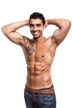 Man showing his great shape over white background