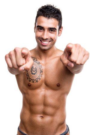 packs: Fit man pointing front over white background Stock Photo