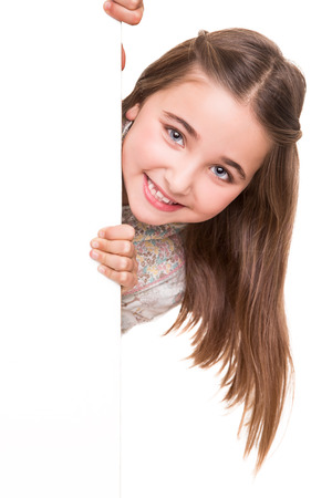child holding sign: Cute little girl behind a white board Stock Photo