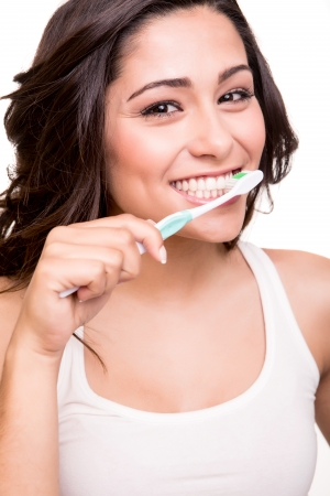 tooth brush: Smiling young woman with healthy teeth holding a tooth brush