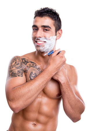 Man shaving his face over white background photo