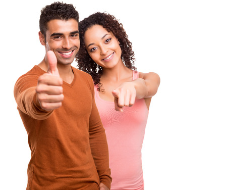 Beautiful mixed race couple over white background