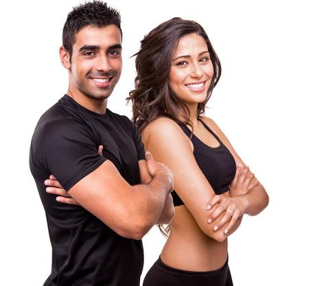 girl fitness: Fitness instructors posing over white background Stock Photo