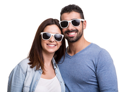 Portrait of a funny couple wearing sunglasses  photo