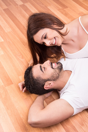 Love Couple at home relaxing on the floor photo