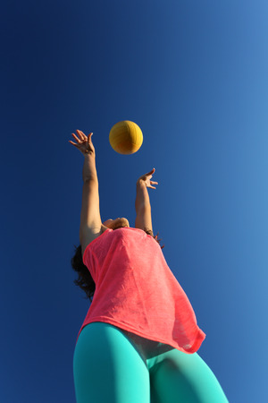 Woman playing with a ball in the city park photo