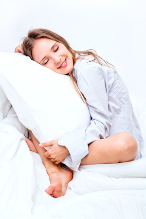 Beautiful young woman sleeping in a bed Stock Photo