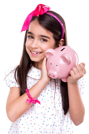 finance girl: Young girl holding a piggy bank over white background Stock Photo