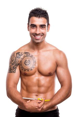 hombre flaco: Gimnasio medir su cuerpo sobre fondo blanco Hombre Foto de archivo